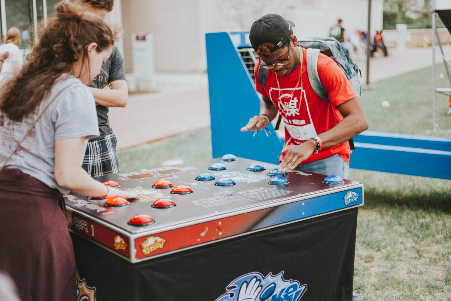 Former SGA club liaison, Shannon Burbank, and a student playing a game during Spring Bash